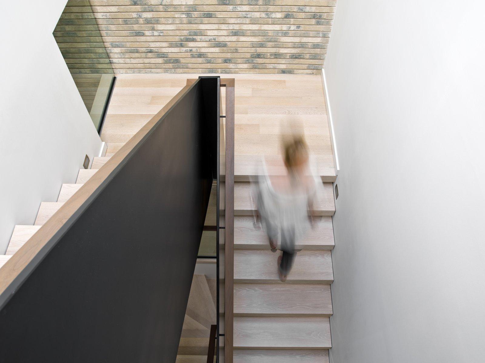 Staircase, Wood Tread, Wood Railing, and Metal Railing  Eastwood Residence by Searl Lamaster Howe