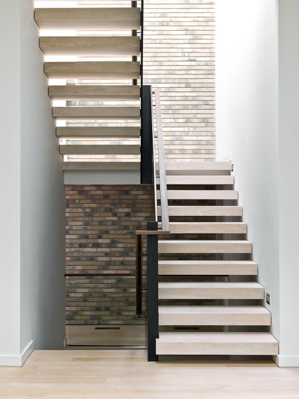 Staircase, Metal Railing, Wood Tread, and Wood Railing  Eastwood Residence by Searl Lamaster Howe