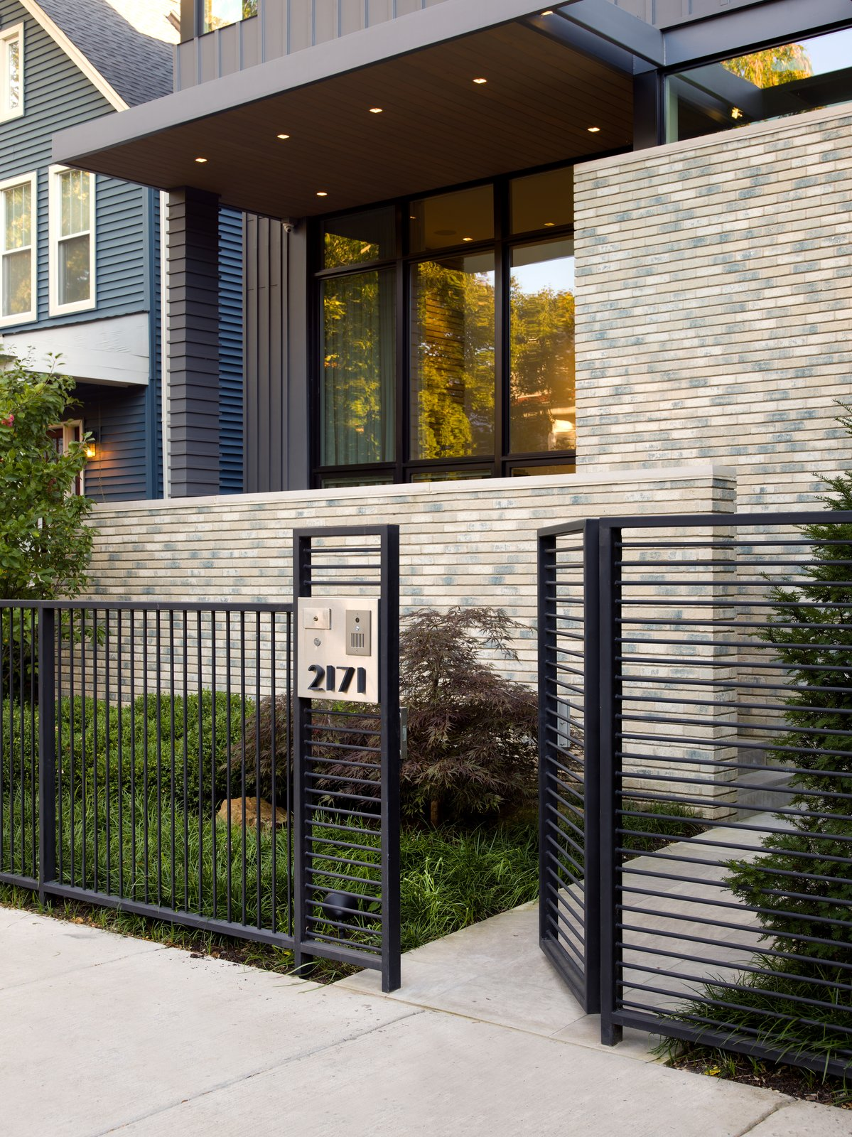 Outdoor, Hardscapes, Front Yard, Horizontal Fences, Wall, Stone Patio, Porch, Deck, Wood Fences, Wall, Shrubs, Pavers Patio, Porch, Deck, Landscape Lighting, Grass, Small Patio, Porch, Deck, and Metal Fences, Wall  Eastwood Residence by Searl Lamaster Howe