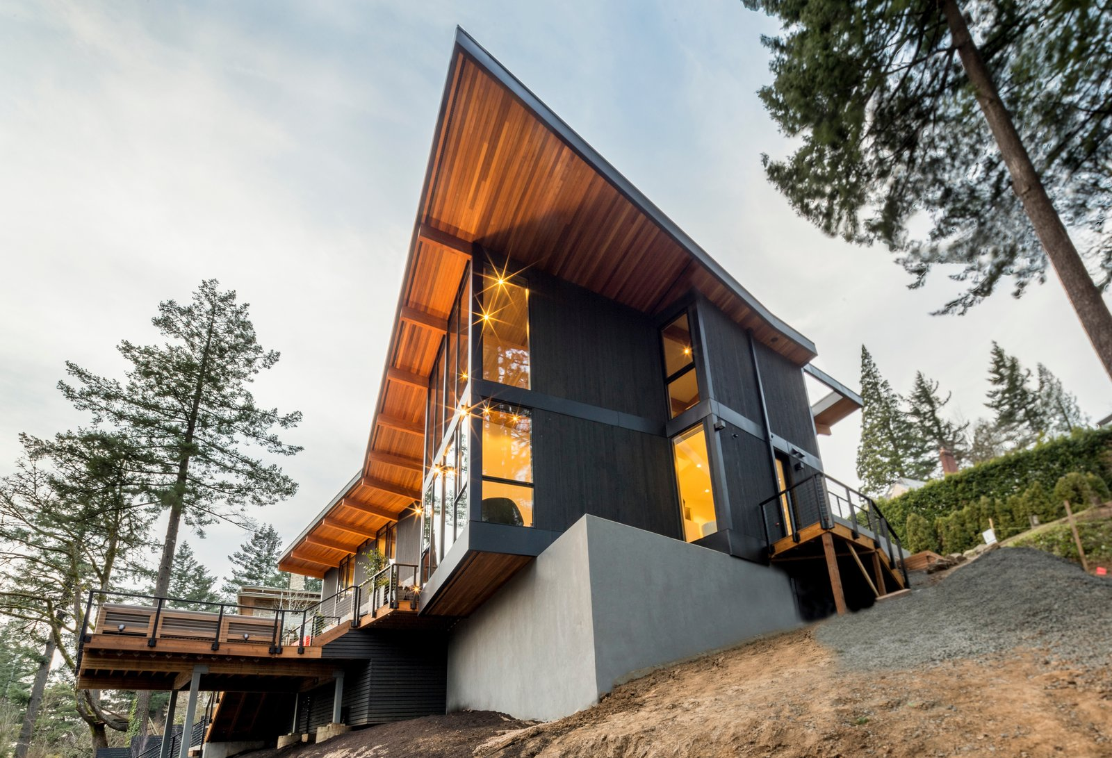 Exterior, Wood Siding Material, House Building Type, Brick Siding Material, and Butterfly RoofLine Back  The Greenhills House