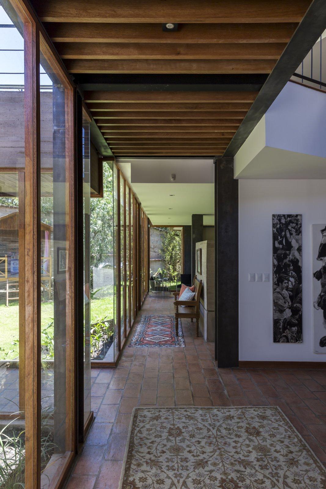 Hallway, Ceramic Tile Floor, and Concrete Floor  La casa en la quebrada by DIEZ + MULLER ARQUITECTOS