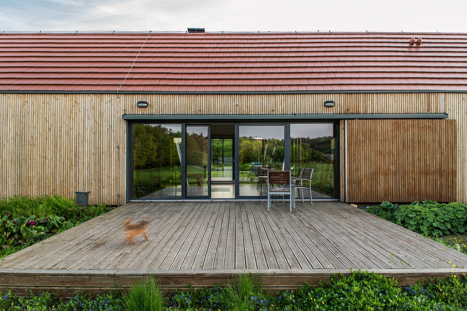 Exterior, House Building Type, Wood Siding Material, A-Frame RoofLine, Tile Roof Material, and Farmhouse Building Type  Nowa Górka by Studio GAB
