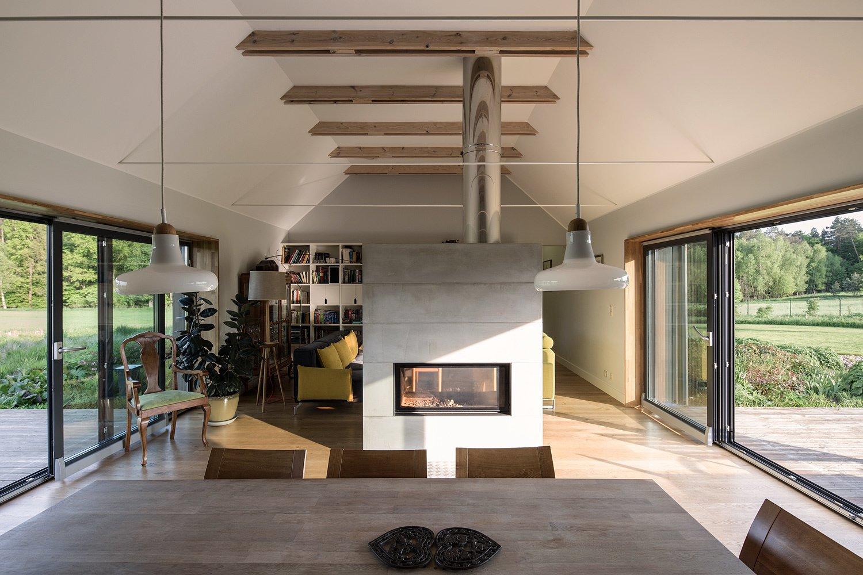 Living Room, Two-Sided Fireplace, Ceiling Lighting, and Medium Hardwood Floor  Nowa Górka by Studio GAB