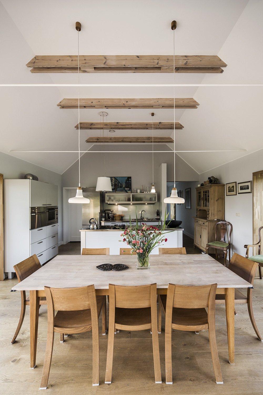 Kitchen, Medium Hardwood Floor, White Cabinet, Ceiling Lighting, Refrigerator, and Wall Oven  Nowa Górka by Studio GAB