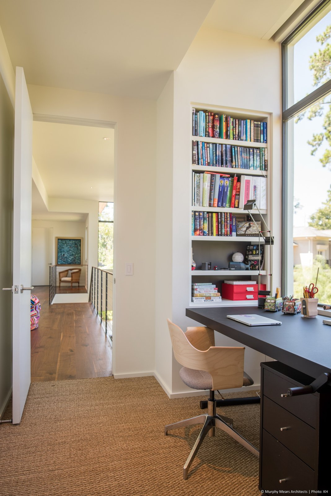 Office, Study Room Type, Chair, Shelves, Desk, Storage, Bookcase, Lamps, Medium Hardwood Floor, Rug Floor, and Carpet Floor  Open House by Murphy Mears Architects