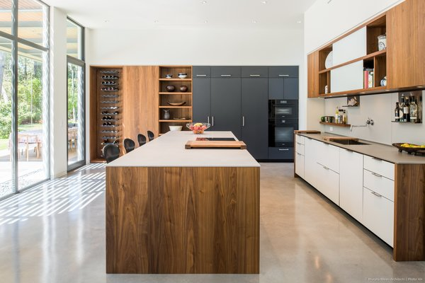 Kitchen, Engineered Quartz, White, Colorful, Wood, Concrete, Glass Tile, Stone Slab, Ceiling, Refrigerator, Microwave, Dishwasher, Wall Oven, Cooktops, and Undermount  Best Kitchen Glass Tile Dishwasher Photos from Open House