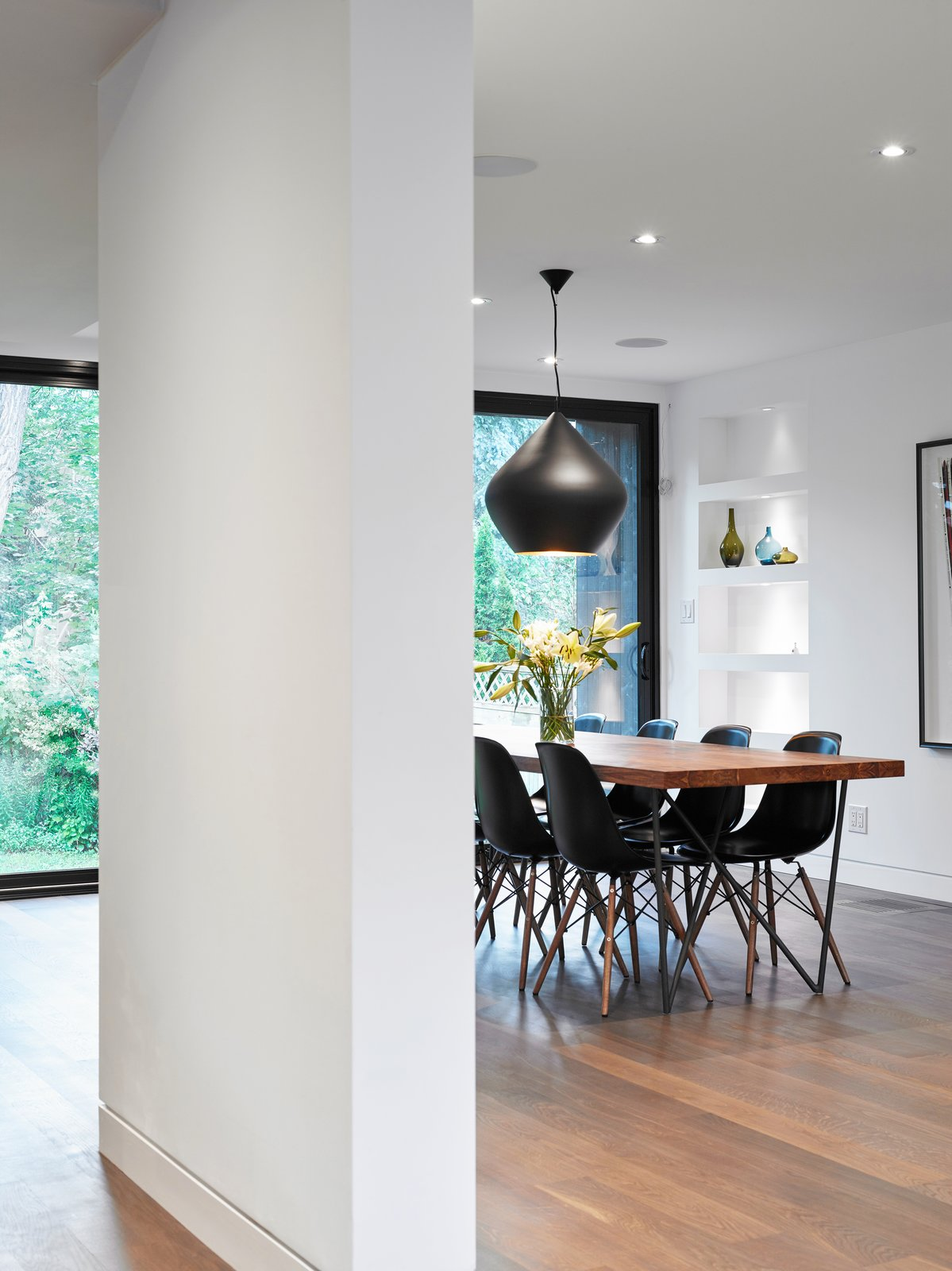 Dining Room, Recessed Lighting, Chair, Pendant Lighting, Shelves, Table, and Medium Hardwood Floor  Hibou House by Barbora Vokac Taylor Architect