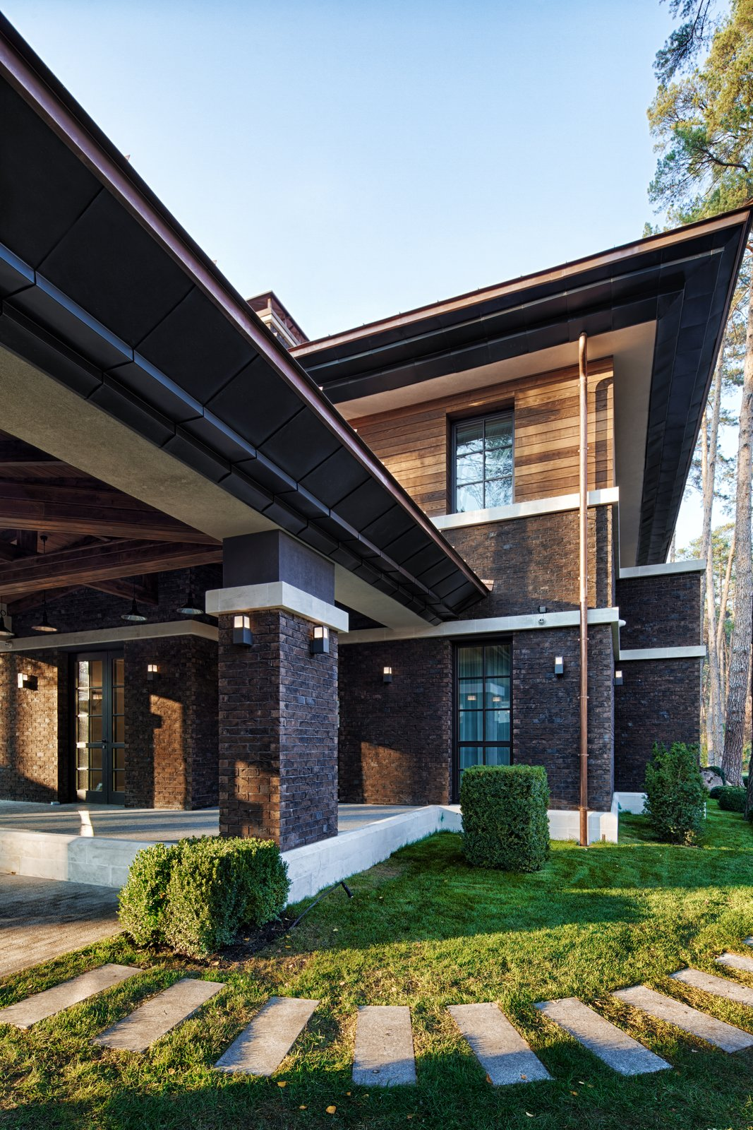 Exterior, House Building Type, Metal Roof Material, Wood Siding Material, and Brick Siding Material  Prairie House by 33bY Architecture