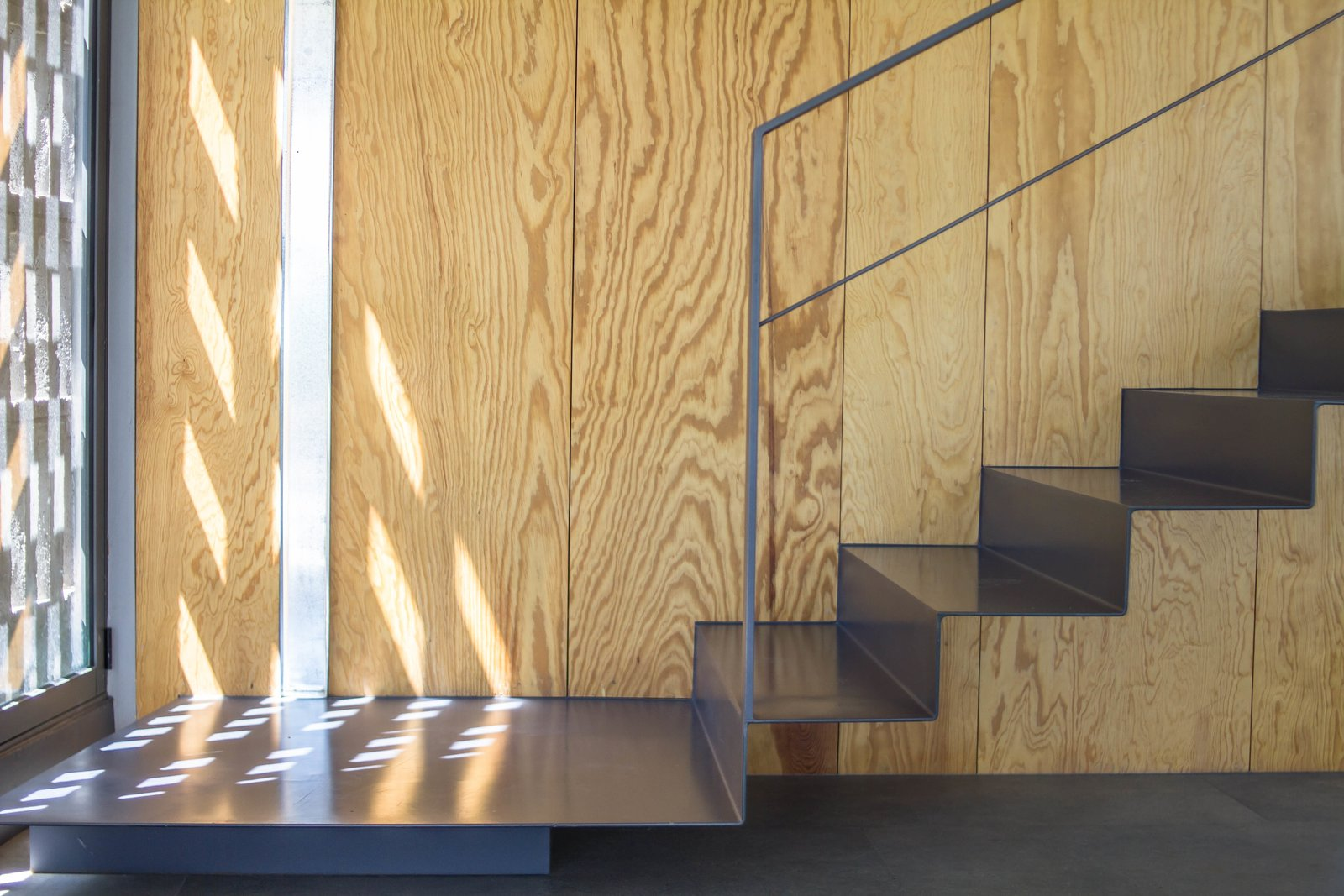 Staircase, Metal Tread, and Metal Railing  CASA HOST by Claudia PCampos