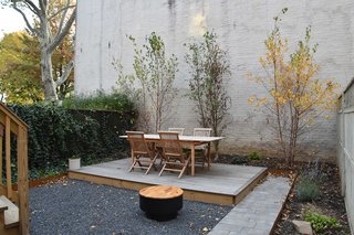 A variety of hardscapes offer a variety of textures and visual interest to this small backyard.