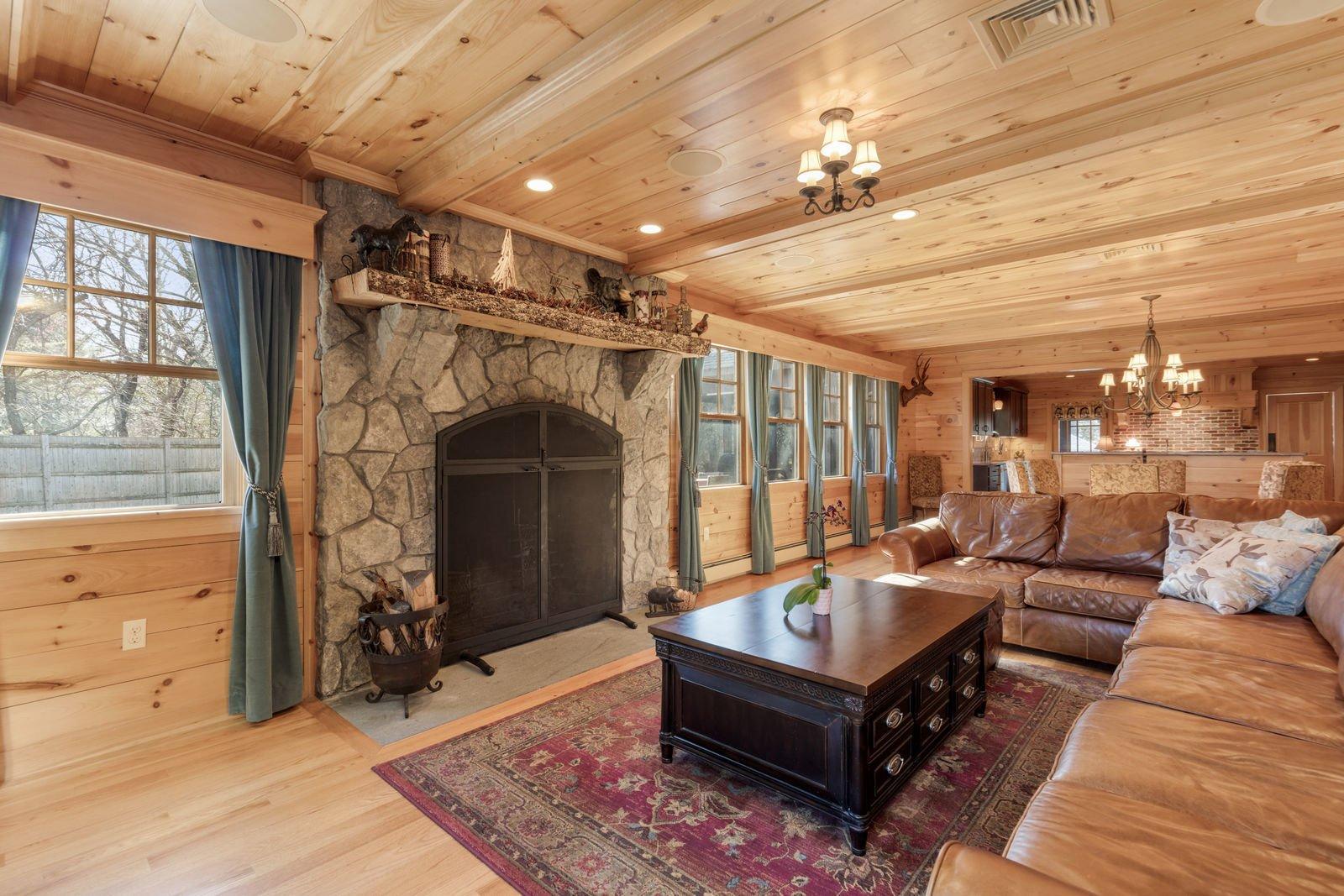 Medium Hardwood Floor, Living Room, and Ceiling Lighting  Shingle Style Rustic Chic