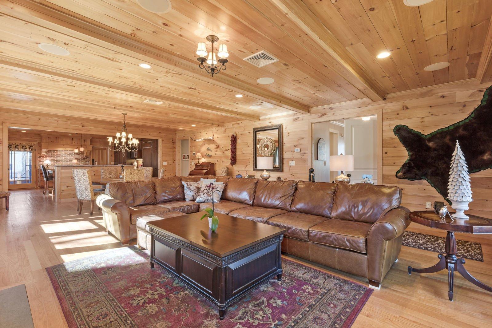 Living Room, Ceiling Lighting, Sectional, Recessed Lighting, and Medium Hardwood Floor  Shingle Style Rustic Chic