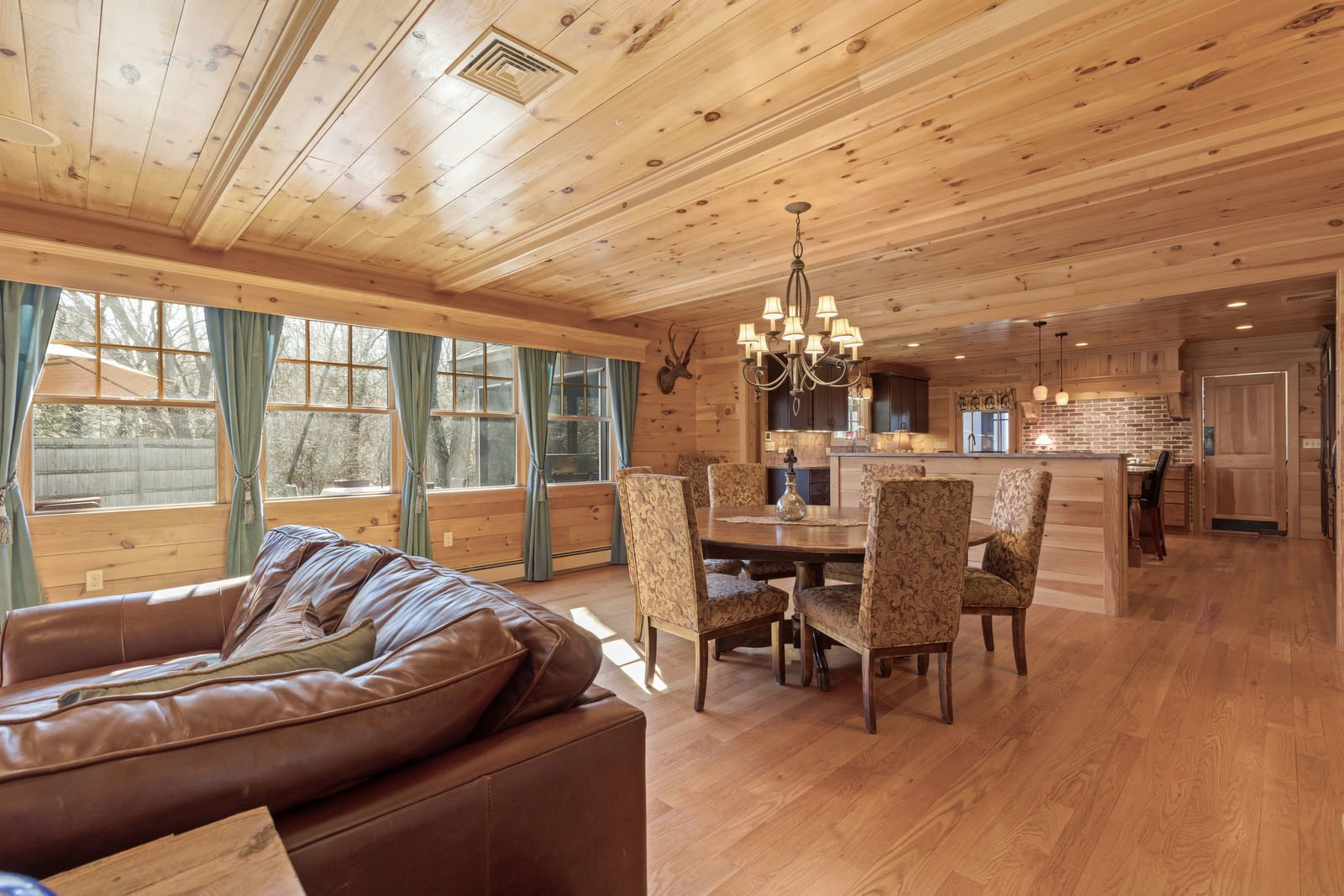 Dining Room, Chair, Table, Ceiling Lighting, and Medium Hardwood Floor  Shingle Style Rustic Chic
