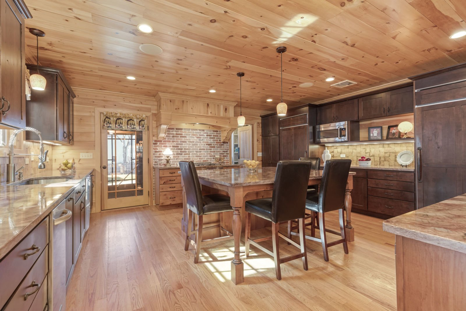 Kitchen, Recessed Lighting, Dishwasher, Granite Counter, Medium Hardwood Floor, Wood Cabinet, Refrigerator, Ceiling Lighting, and Undermount Sink  Shingle Style Rustic Chic