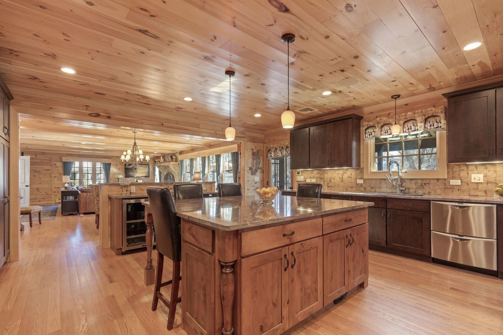 Kitchen, Wood Cabinet, Wine Cooler, Granite Counter, Dishwasher, and Medium Hardwood Floor  Shingle Style Rustic Chic