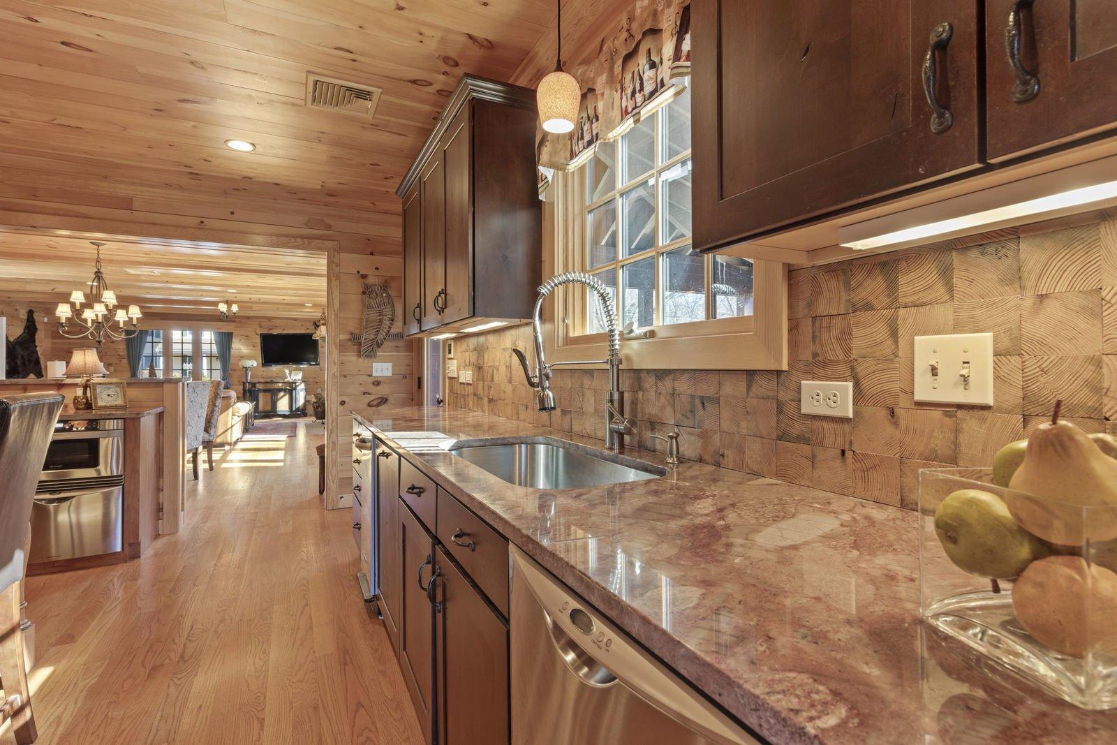 Kitchen, Medium Hardwood Floor, Dishwasher, Wood Cabinet, Undermount Sink, and Granite Counter  Shingle Style Rustic Chic
