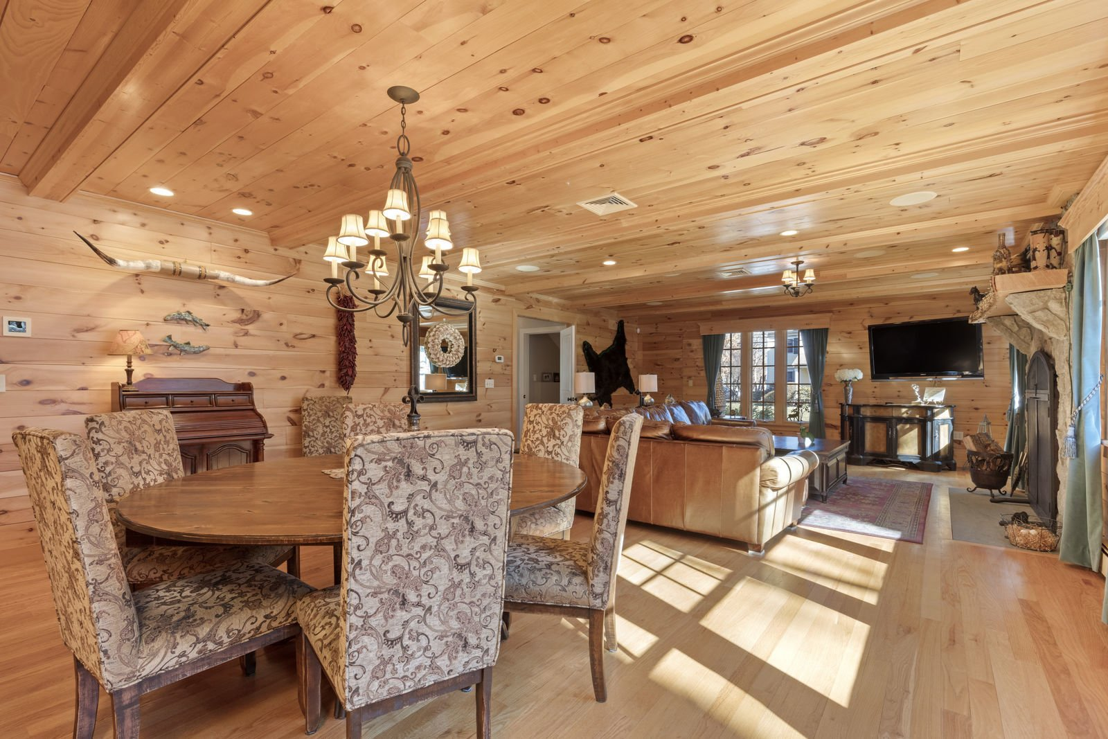 Dining Room, Ceiling Lighting, Table, Medium Hardwood Floor, and Chair  Shingle Style Rustic Chic