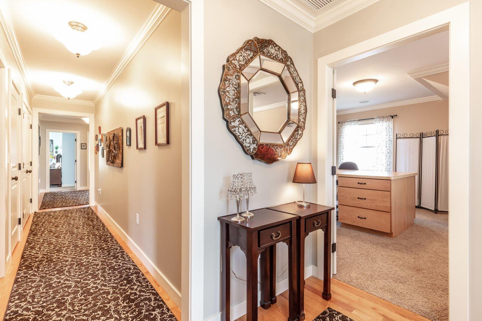 Hallway and Medium Hardwood Floor  Shingle Style Rustic Chic