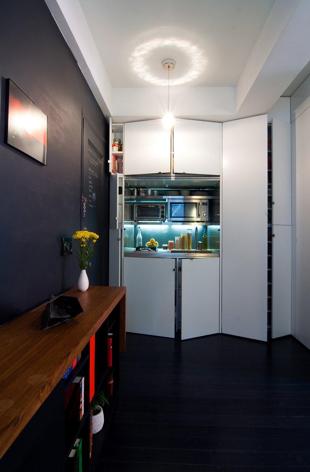 Kitchen, White Cabinet, Bamboo Floor, Metal Backsplashe, Microwave, Metal Counter, Wood Counter, Cooktops, Range, Pendant Lighting, Ceiling Lighting, Refrigerator, and Undermount Sink  Park Avenue Studio