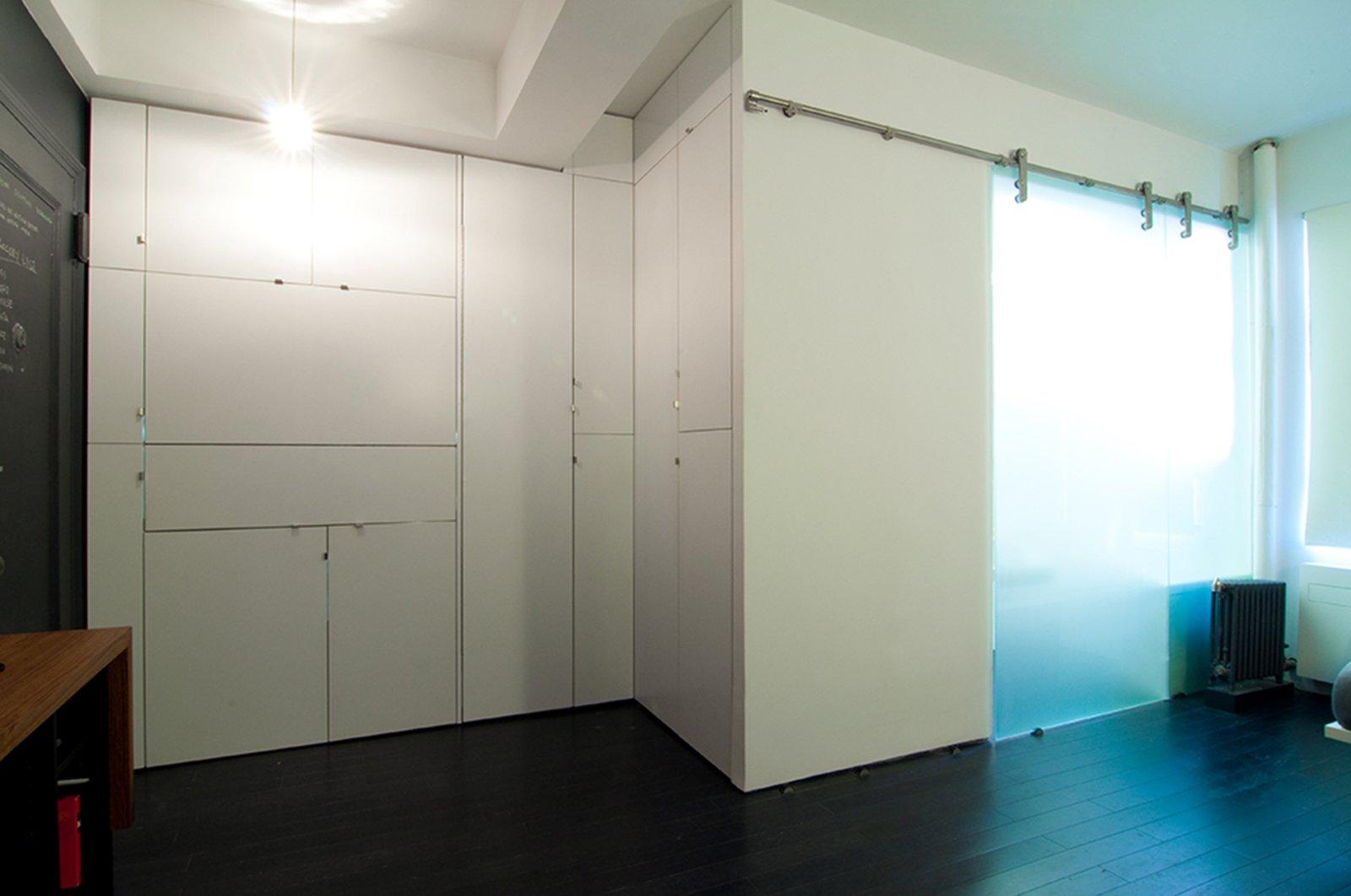 Kitchen, White Cabinet, Bamboo Floor, and Pendant Lighting  Park Avenue Studio