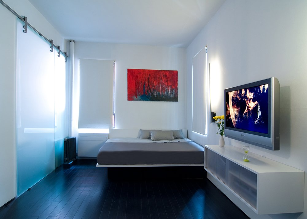 Bedroom, Bamboo Floor, Bed, Ceiling Lighting, Dark Hardwood Floor, and Storage  Park Avenue Studio