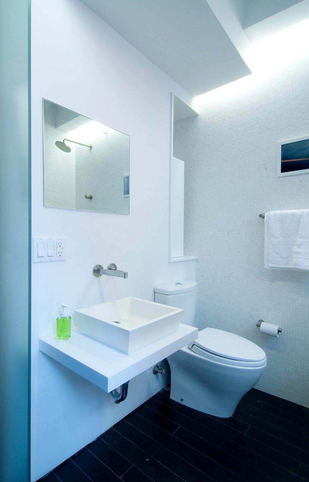 Bath Room, Vessel Sink, Dark Hardwood Floor, and Mosaic Tile Wall  Park Avenue Studio