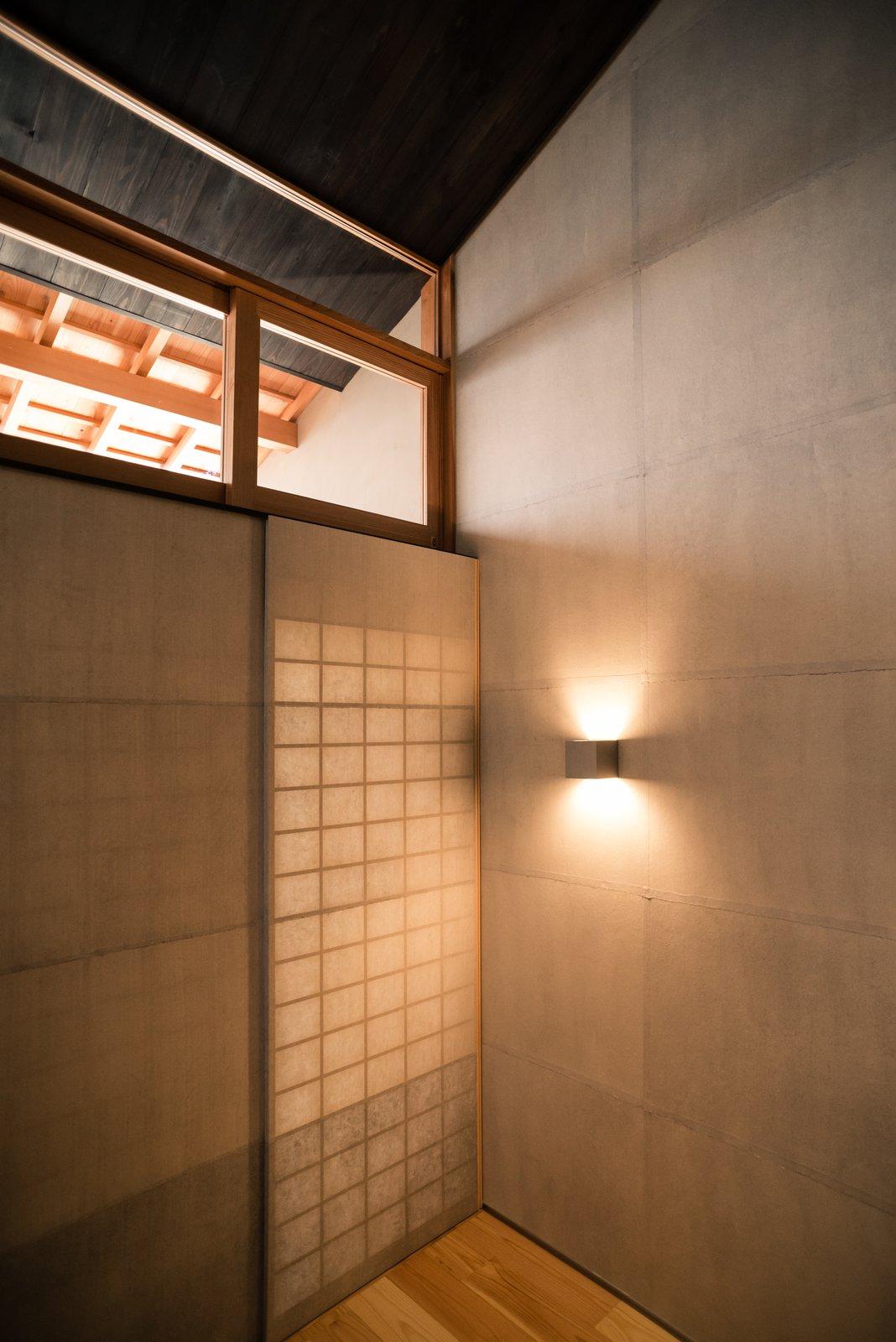 Living Room, Light Hardwood Floor, and Wall Lighting  Ichijoji House by atelier Luke