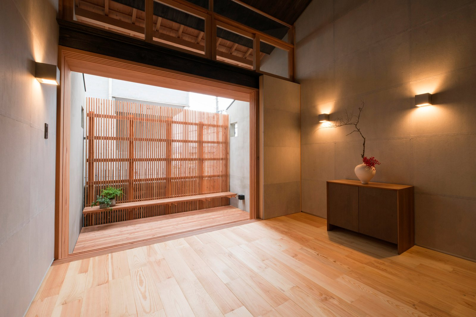 Living Room, Light Hardwood Floor, Storage, and Wall Lighting  Ichijoji House by atelier Luke