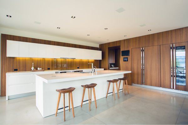 Kitchen, Engineered Quartz, Wood, Concrete, Refrigerator, Beverage Center, and Wine Cooler  Best Kitchen Engineered Quartz Beverage Center Photos from Kelowna Lake House