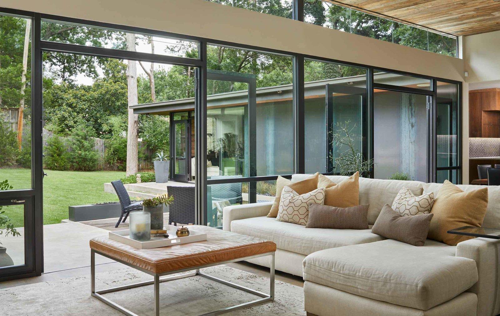 Living Room, Sofa, Sectional, Coffee Tables, End Tables, and Medium Hardwood Floor  Kessler Residence