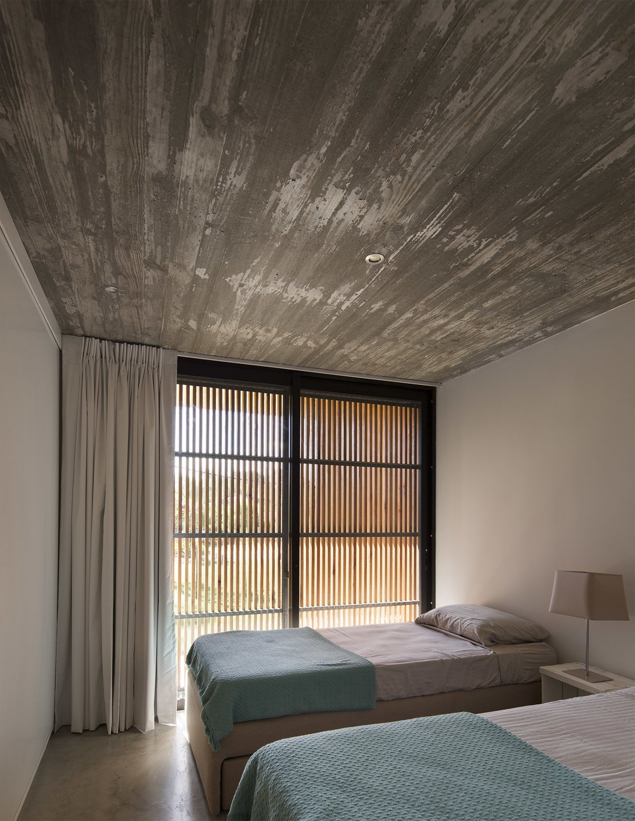 Bedroom, Bed, Ceiling Lighting, and Concrete Floor  MARINDIA HOUSE