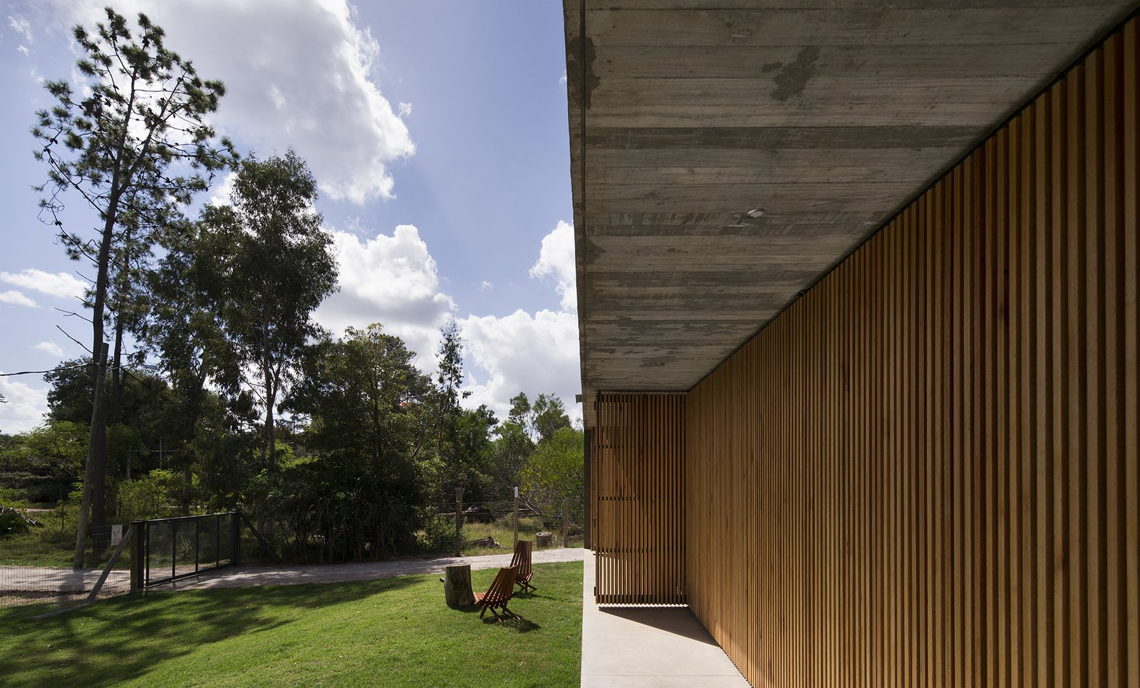 Outdoor, Trees, Front Yard, Grass, Gardens, Vegetables, Vertical Fences, Wall, Wood Fences, Wall, and Concrete Fences, Wall  MARINDIA HOUSE
