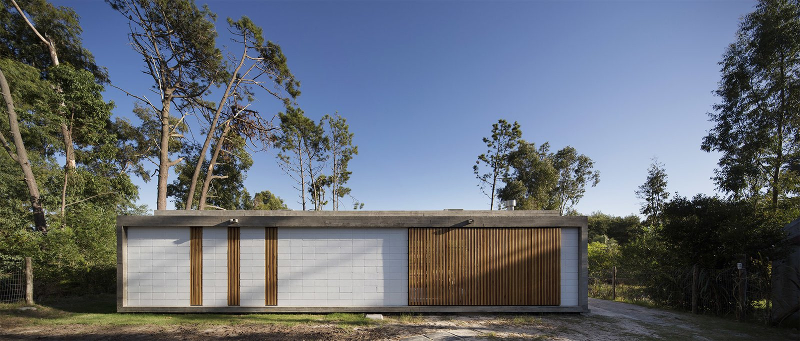Exterior, House Building Type, Wood Siding Material, Concrete Siding Material, and Flat RoofLine  MARINDIA HOUSE