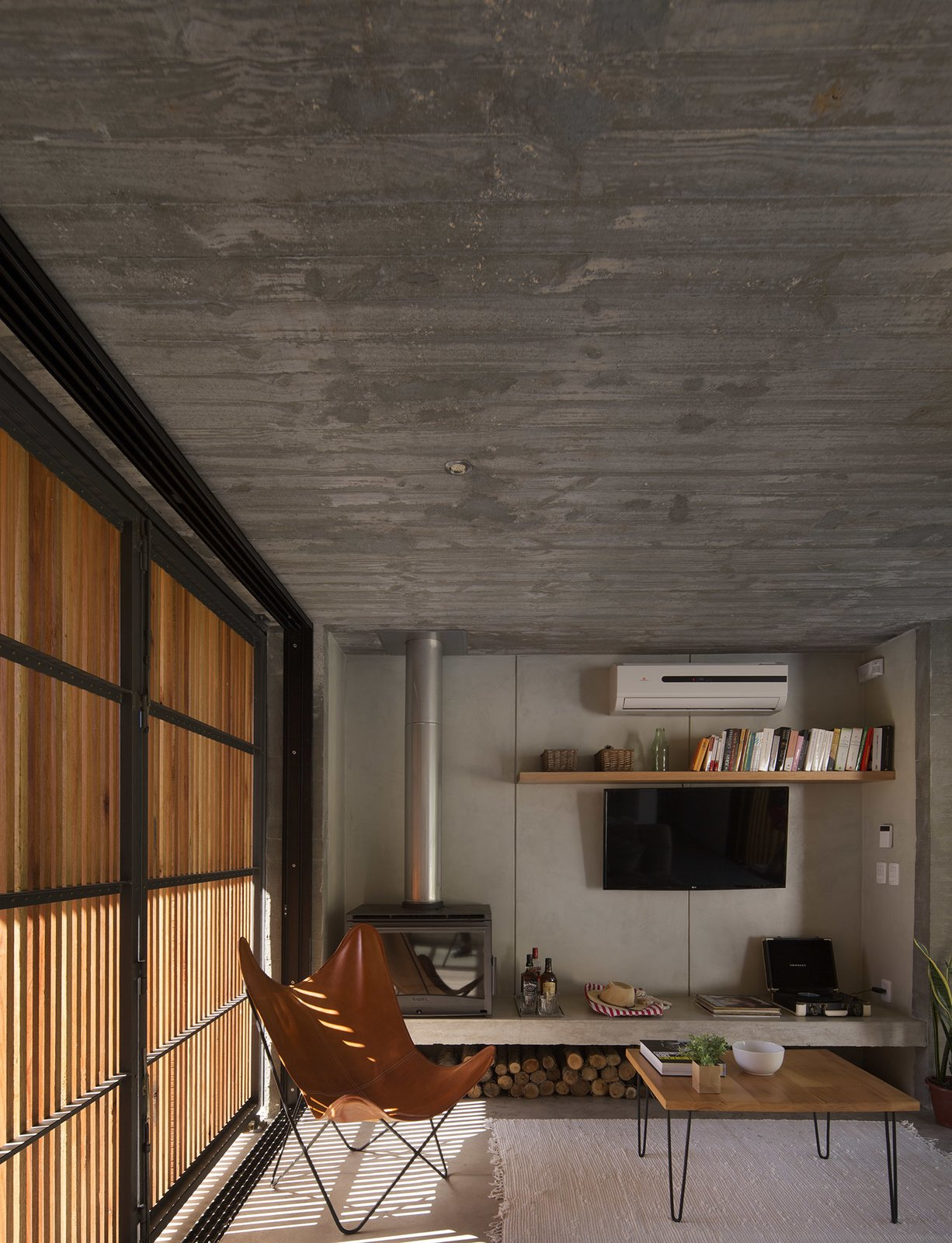 Living Room, Chair, Sofa, Ceiling Lighting, and Concrete Floor  MARINDIA HOUSE