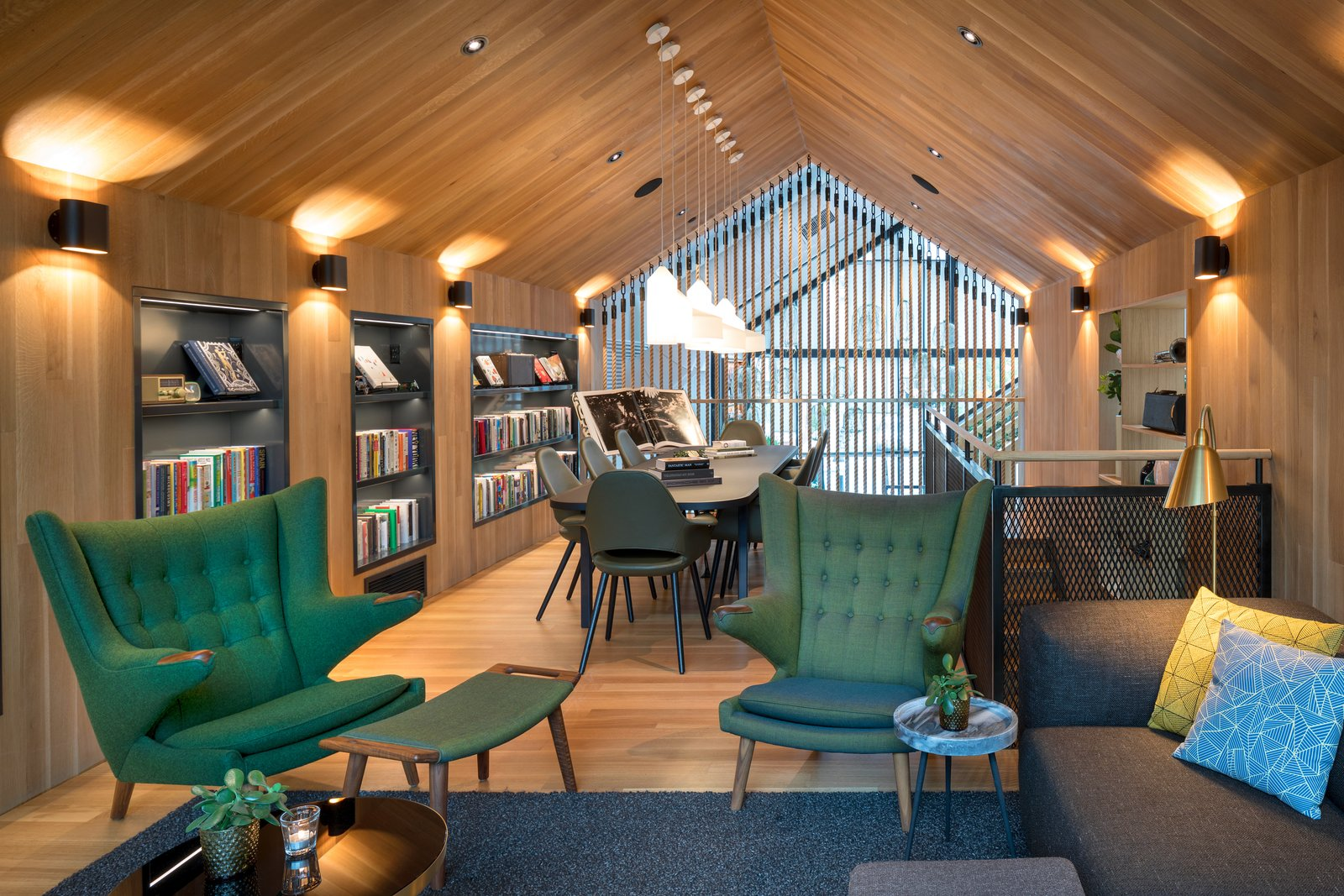 Office, Study Room Type, Library Room Type, Chair, Bookcase, Rug Floor, Shelves, and Light Hardwood Floor  Photo 5 of 7 in Boutique Coffee Roaster Coperaco's First Cafe Holds a Modern Tree House