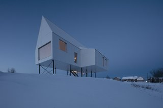 A Minimalist Winter Chalet Stands Tall on Stilts - Photo 4 of 6 -