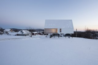 A Minimalist Winter Chalet Stands Tall on Stilts - Photo 2 of 6 -