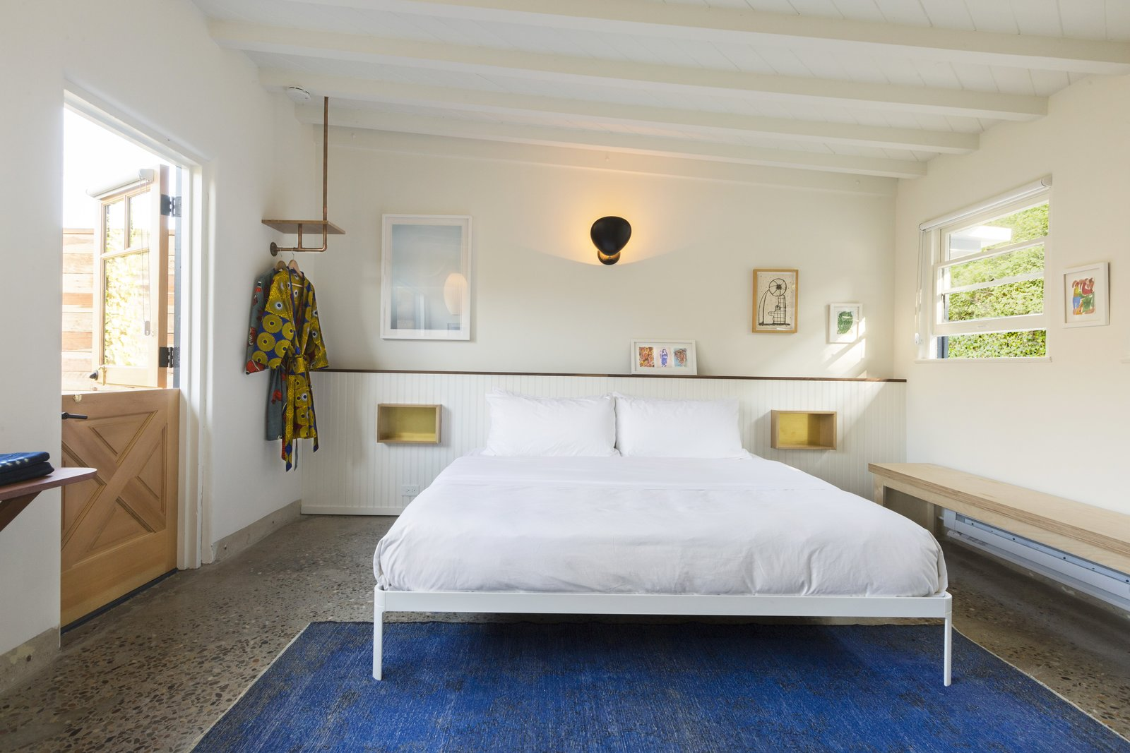 Bedroom, Bed, Bench, Wall, Shelves, Rug, and Terrazzo  Best Bedroom Shelves Bench Photos from Do Malibu in Style With the Native Hotel, a Rejuvenated Hollywood Favorite