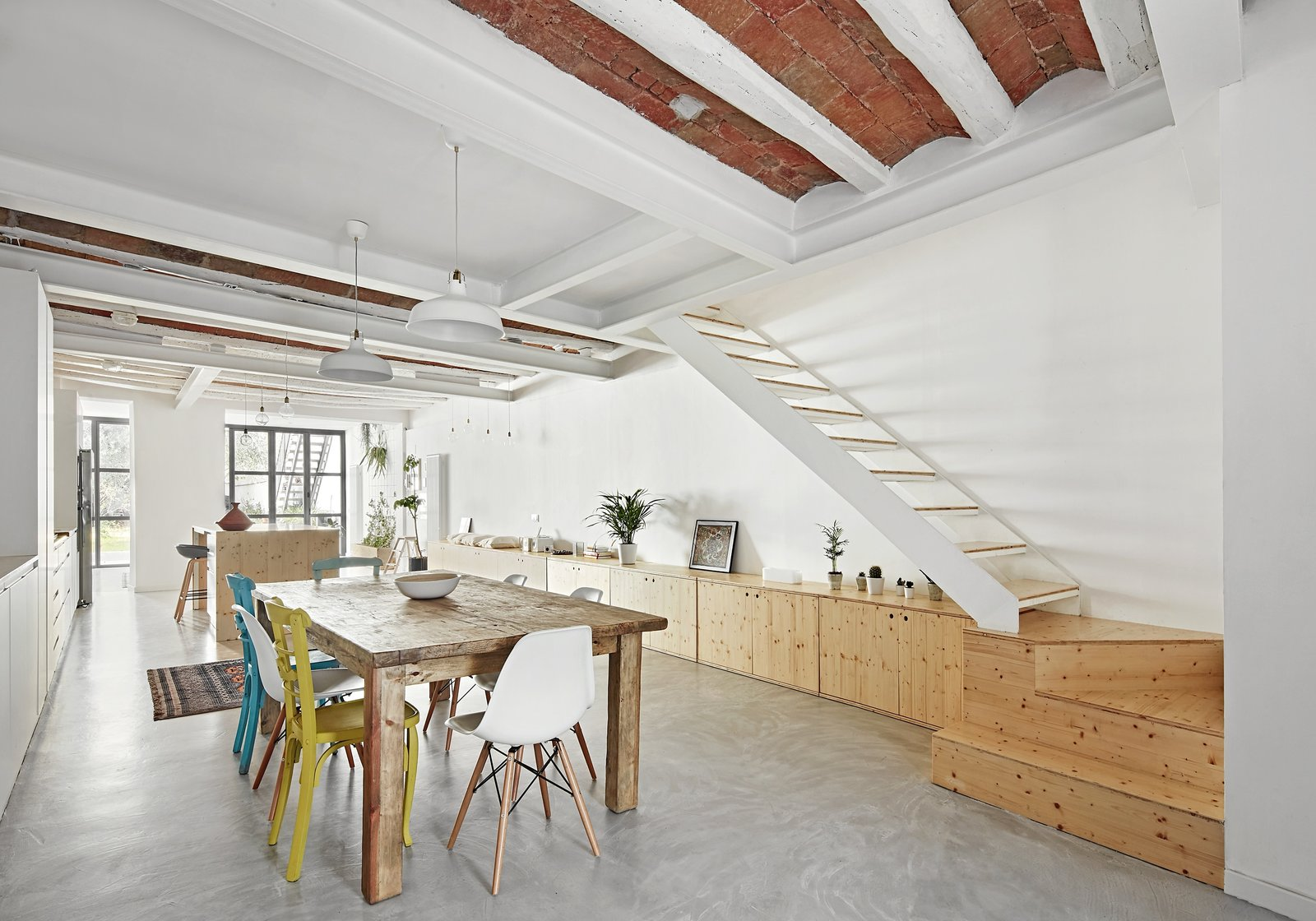 Dining Room, Concrete Floor, Chair, Pendant Lighting, Table, Storage, and Rug Floor  Photo 10 of 11 in Can This Renovated, Loft-Like Home in Spain Be Any Dreamier?