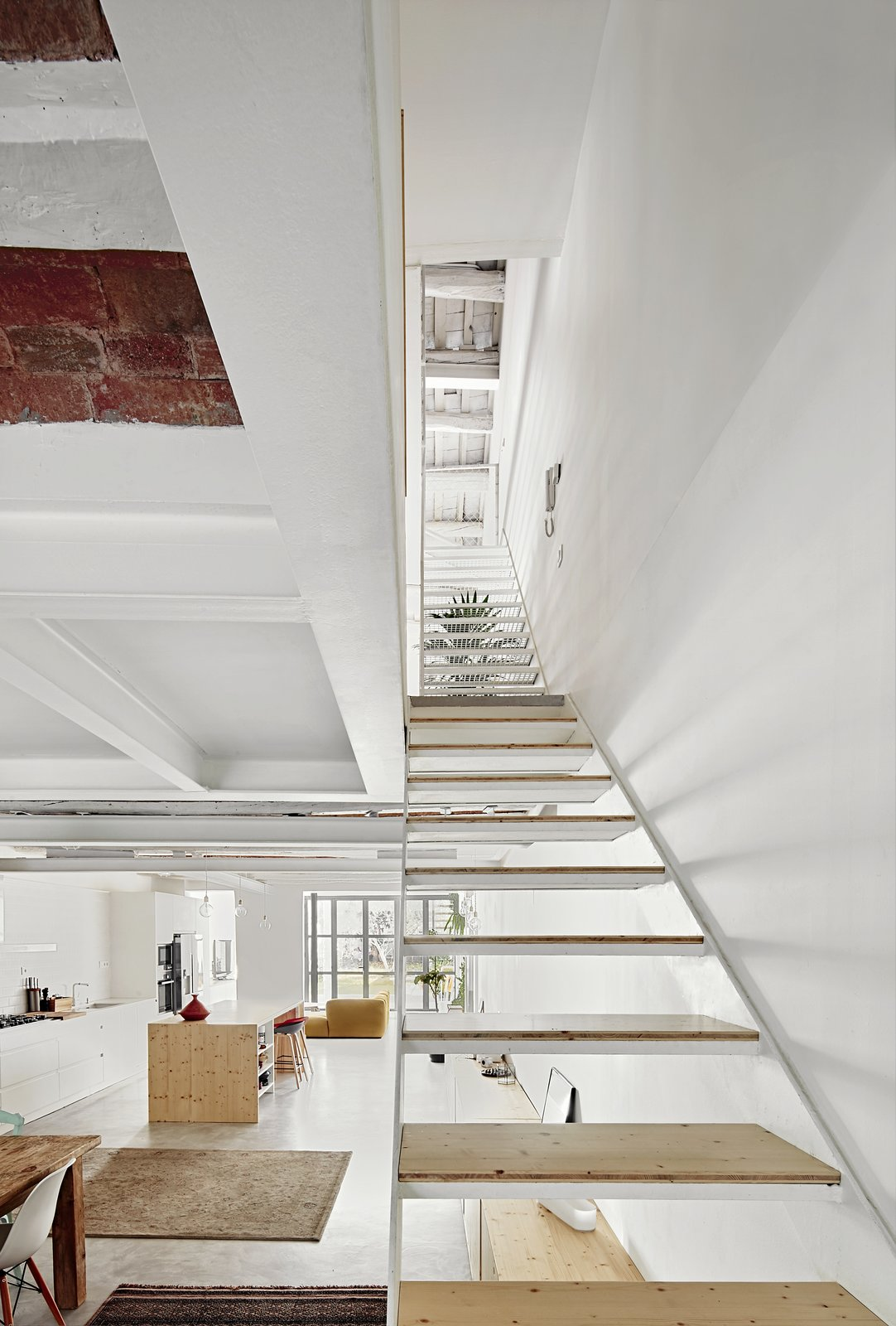 Staircase, Metal Tread, and Wood Tread  Photo 11 of 11 in Can This Renovated, Loft-Like Home in Spain Be Any Dreamier?