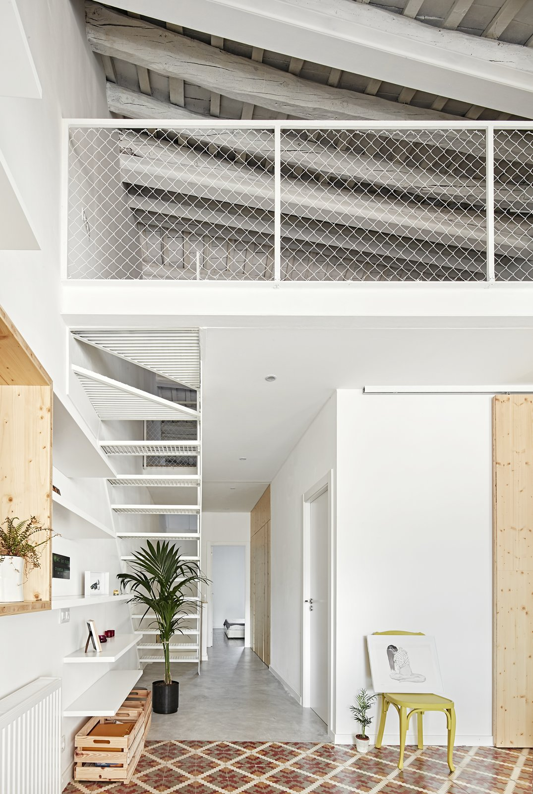 Staircase, Metal Tread, and Metal Railing  Photo 3 of 11 in Can This Renovated, Loft-Like Home in Spain Be Any Dreamier?