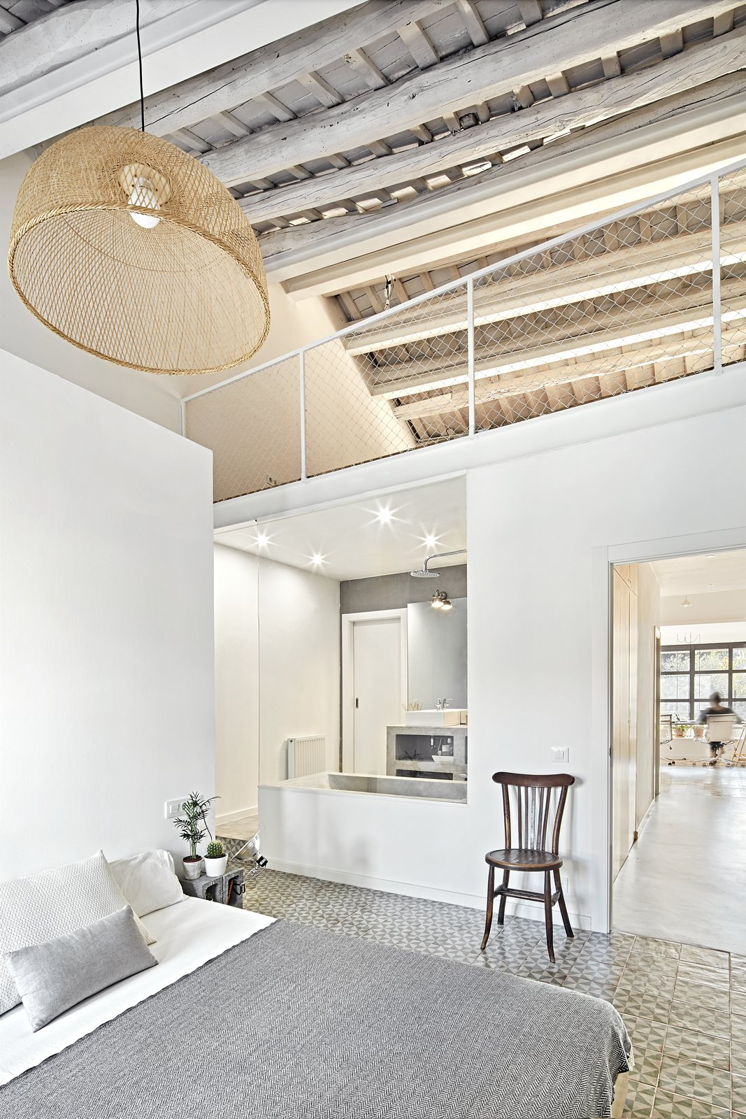 Bedroom, Bed, Pendant Lighting, Chair, and Night Stands  Photo 7 of 11 in Can This Renovated, Loft-Like Home in Spain Be Any Dreamier?