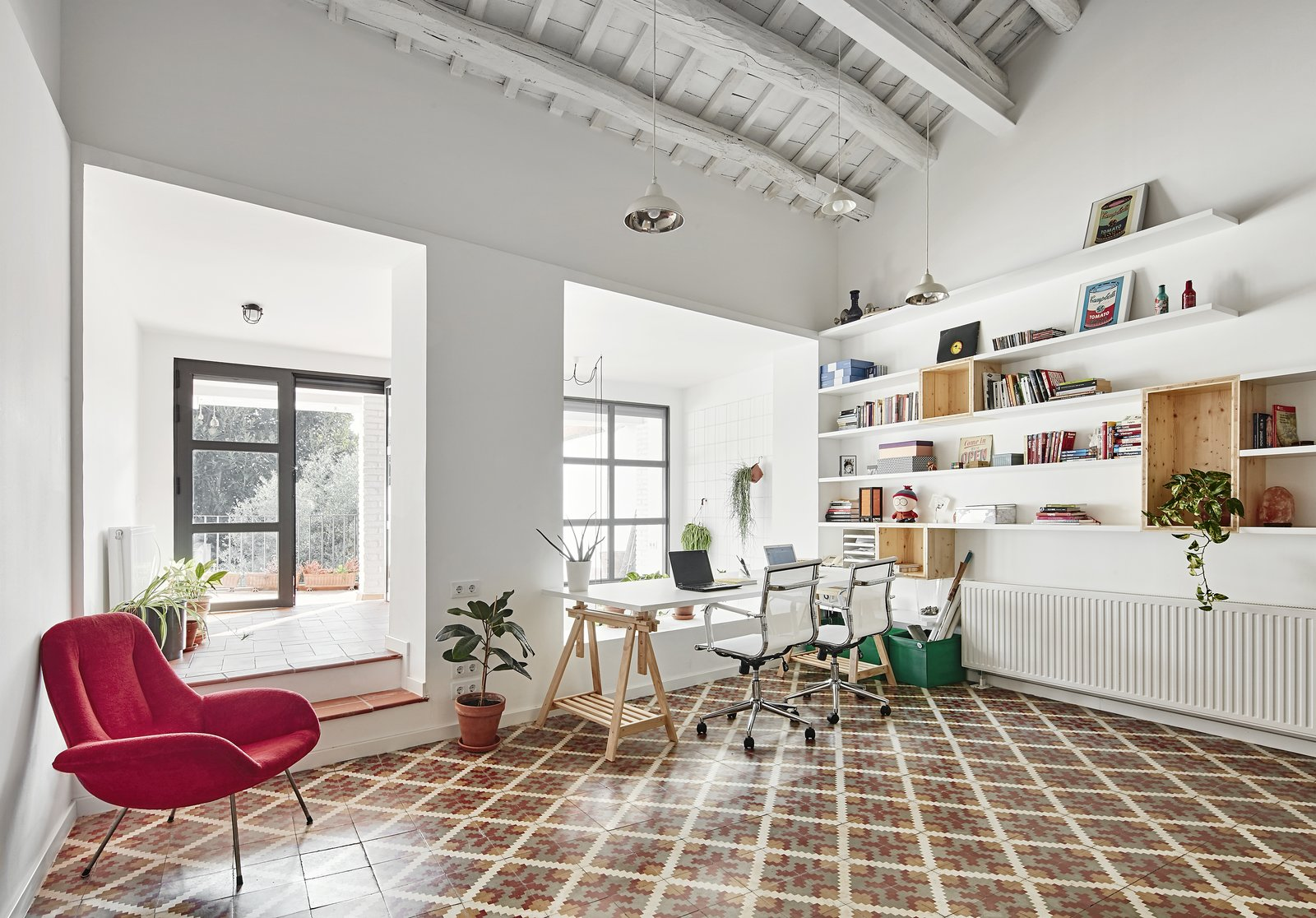 Office, Chair, Desk, Shelves, and Ceramic Tile Floor  Photo 2 of 11 in Can This Renovated, Loft-Like Home in Spain Be Any Dreamier?