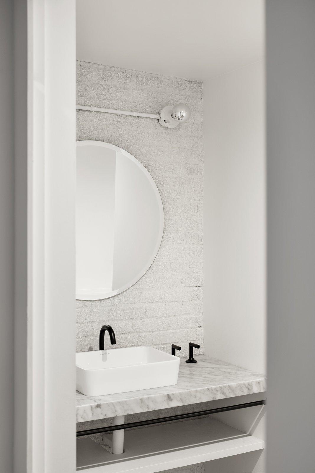 Bath Room, Concrete Floor, Marble Floor, Marble Counter, Vessel Sink, Recessed Lighting, and Wall Lighting  Saint-Laurent Apartment by Atelier Barda