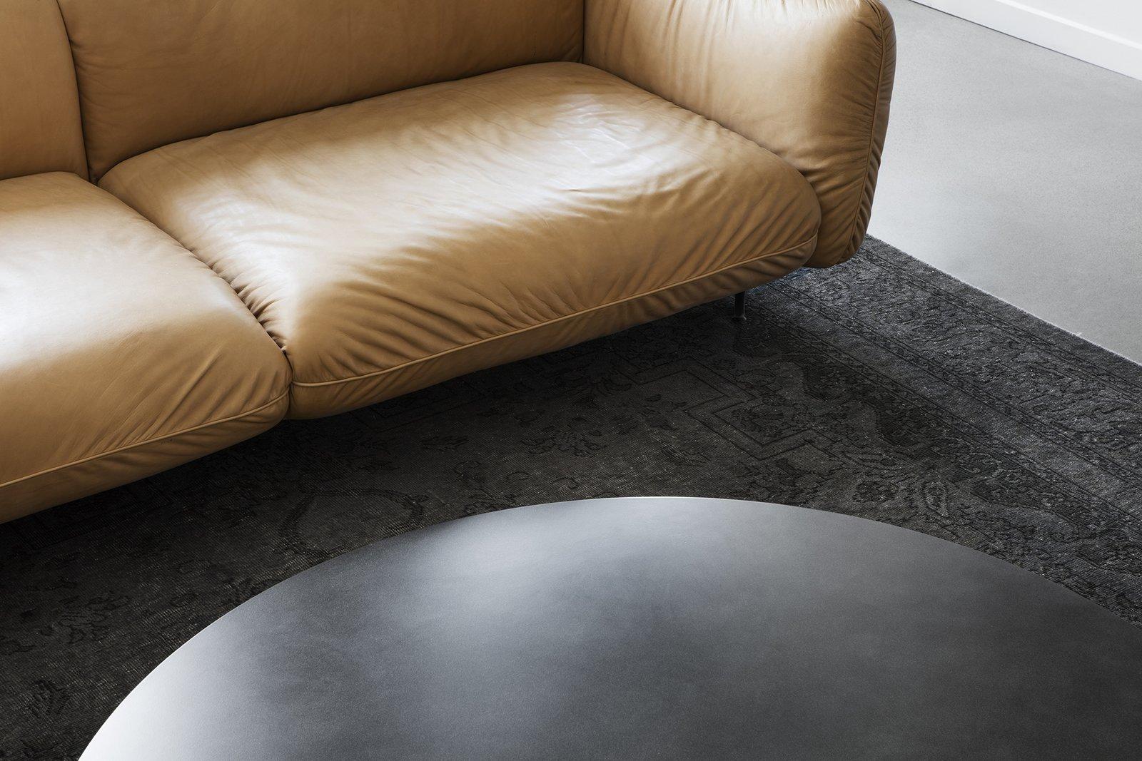 Living Room, Sofa, Coffee Tables, Concrete Floor, and Rug Floor  Saint-Laurent Apartment by Atelier Barda