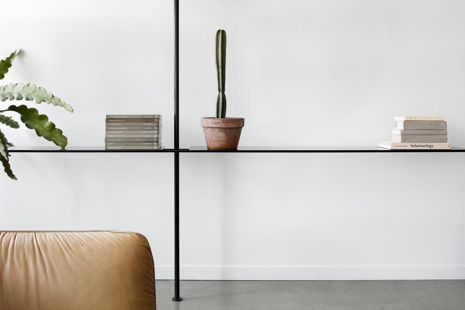 Living Room, Shelves, Sofa, Storage, Concrete Floor, and Bookcase  Saint-Laurent Apartment by Atelier Barda