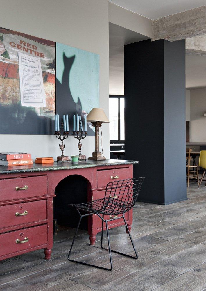 Living Room, Chair, Desk, Lamps, Table Lighting, Medium Hardwood Floor, and Dark Hardwood Floor  Chabrol Apartment by Atelier Barda