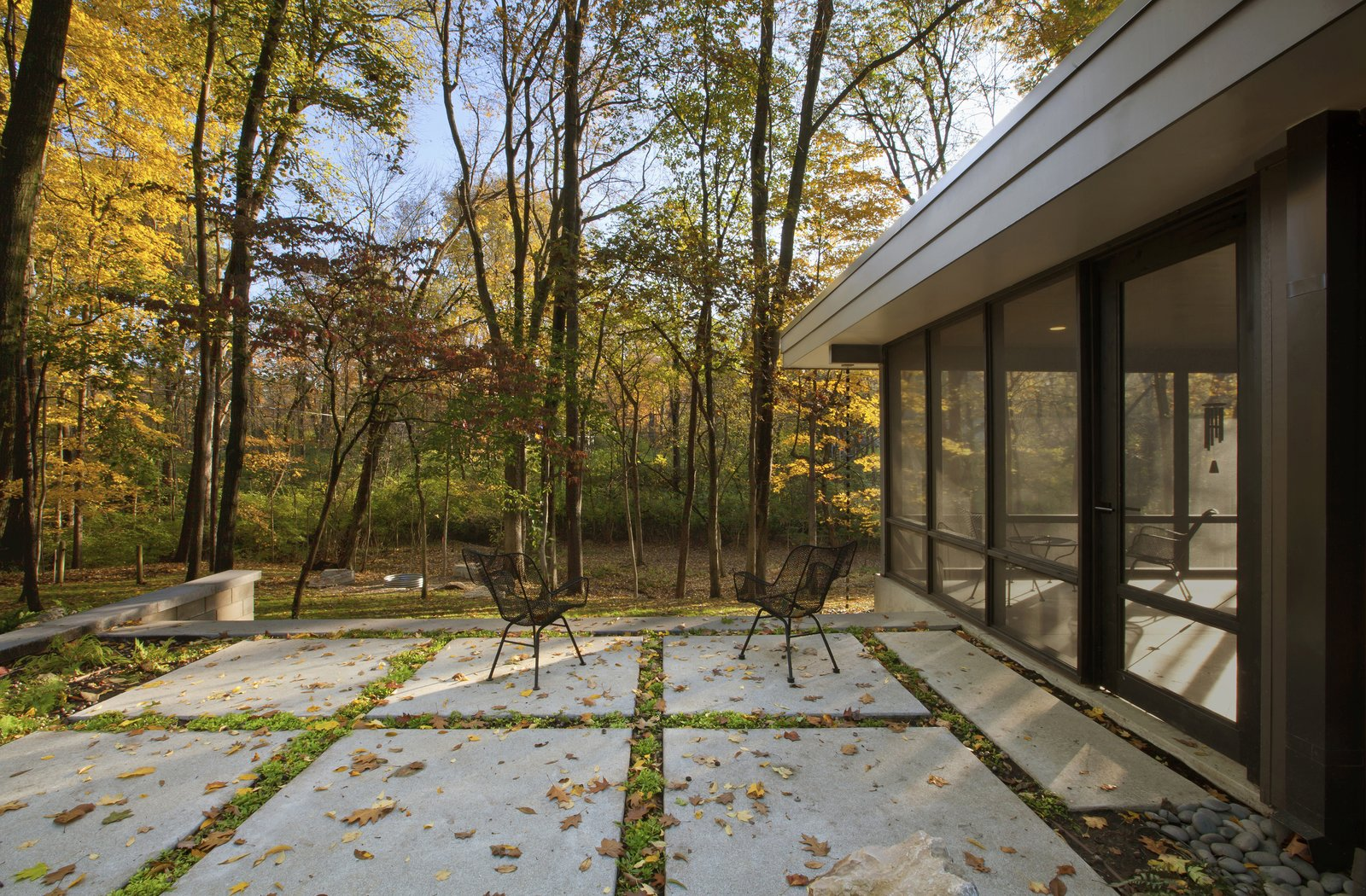 Outdoor, Grass, Landscape Lighting, Walkways, Planters Patio, Porch, Deck, Gardens, Pavers Patio, Porch, Deck, Woodland, Shrubs, Concrete Patio, Porch, Deck, Stone Fences, Wall, Hardscapes, Trees, Back Yard, and Concrete Fences, Wall  MCM 220 by HAUS | Architecture For Modern Lifestyles