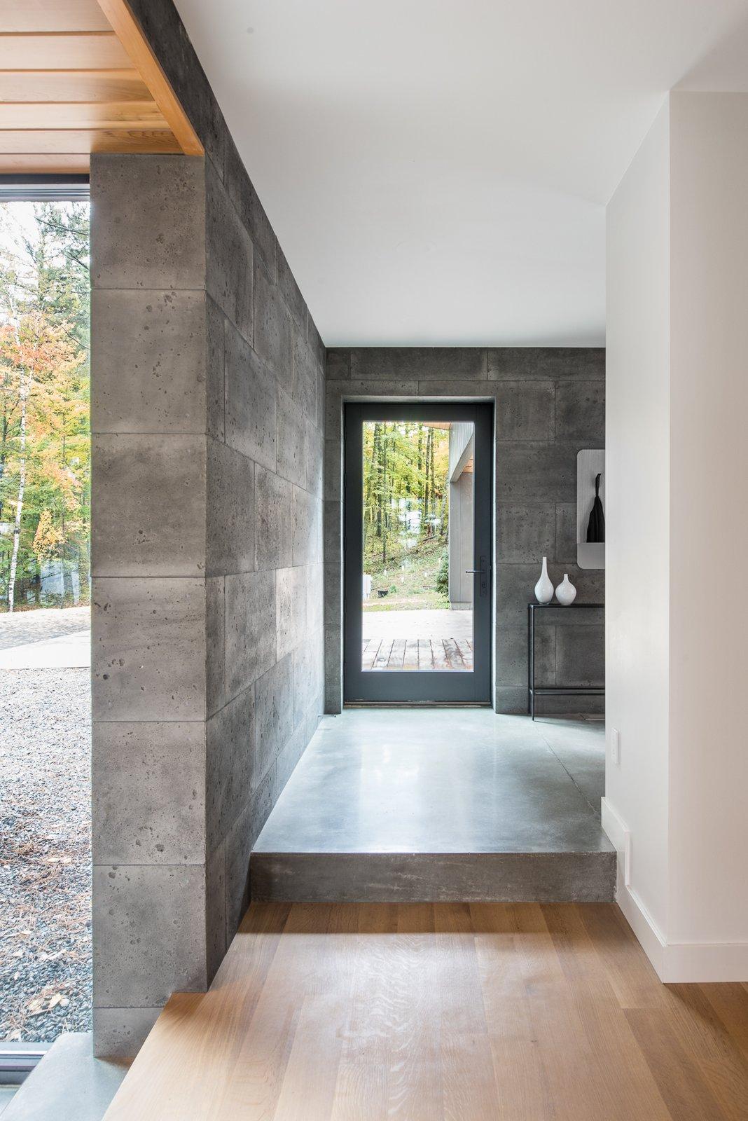 Hallway and Light Hardwood Floor  Northern Lake Home by Strand Design