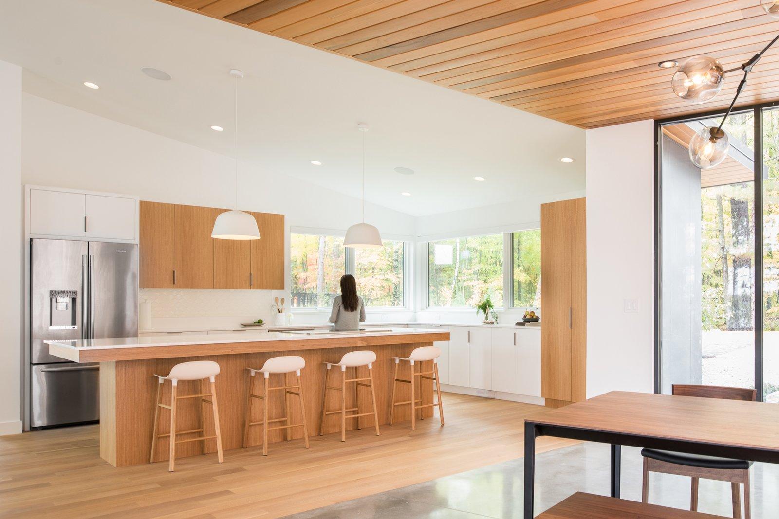 Kitchen, Engineered Quartz, Wood, White, Light Hardwood, Concrete, Ceramic Tile, Ceiling, Refrigerator, Undermount, and Range  Best Kitchen Concrete Undermount Refrigerator White Engineered Quartz Ceiling Photos from Northern Lake Home